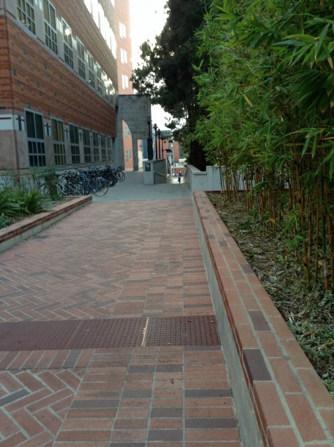 Pedestrian walkway alongside right side of Lot 9, take it to south campus or to Westwood Blvd