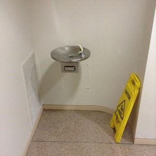 By men's restroom