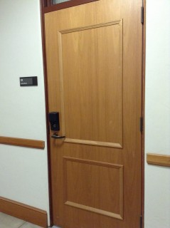 Back door in side hallway, by professor and TA offices